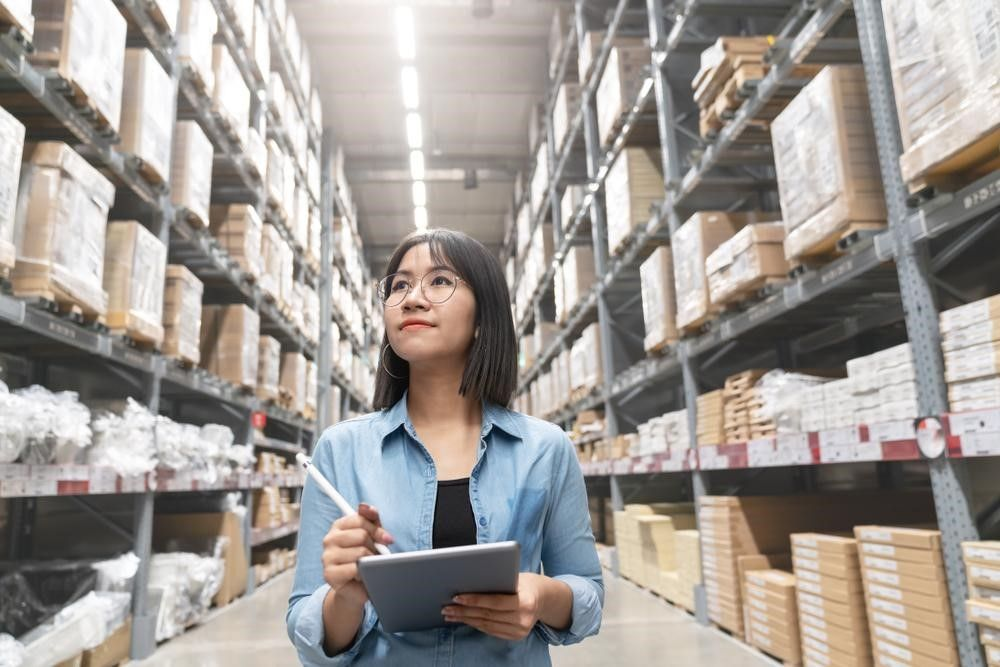 Woman Assessing Supply Chain Challenges