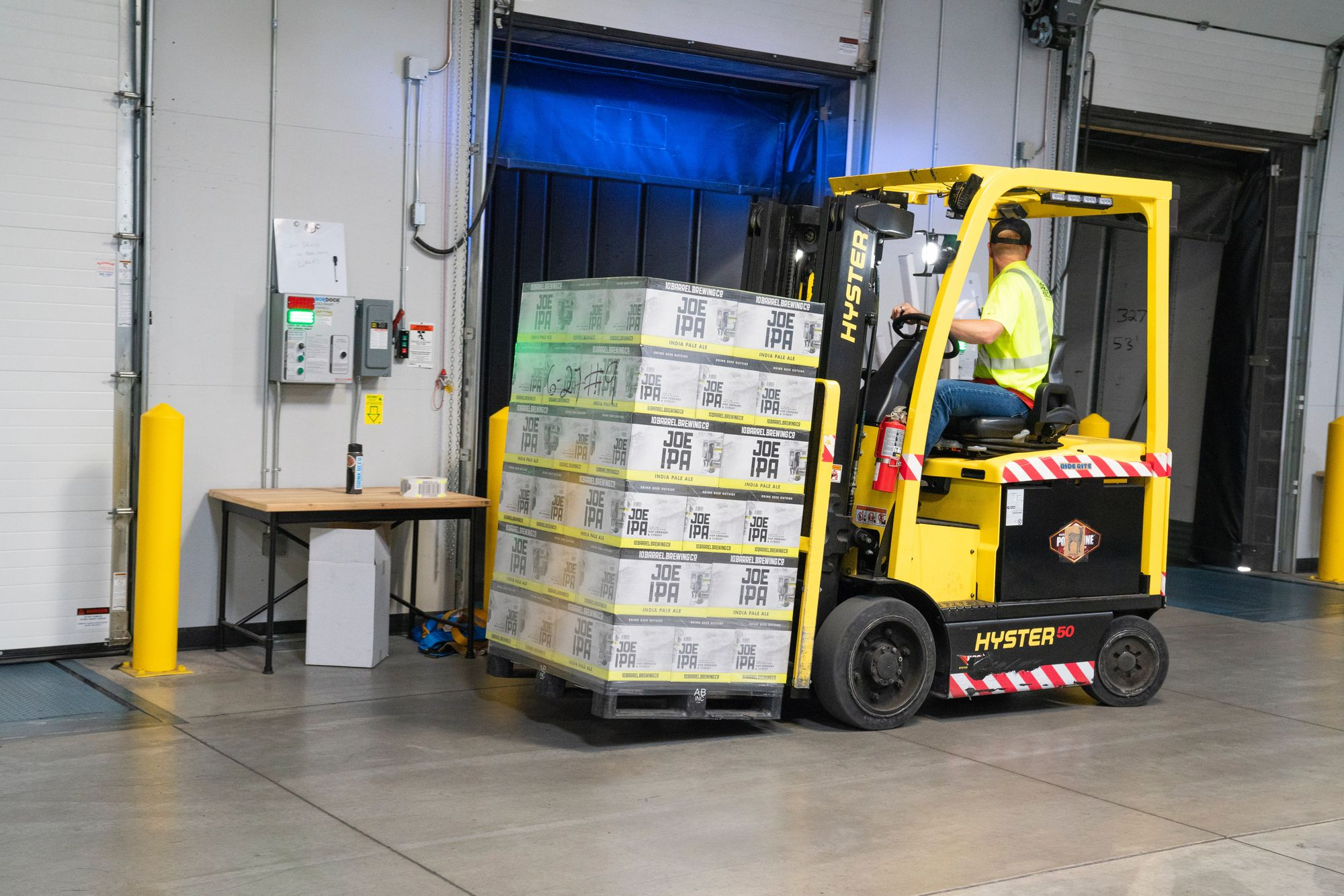 Worker Using Safety Measures to Avoid Damaged Product Returns