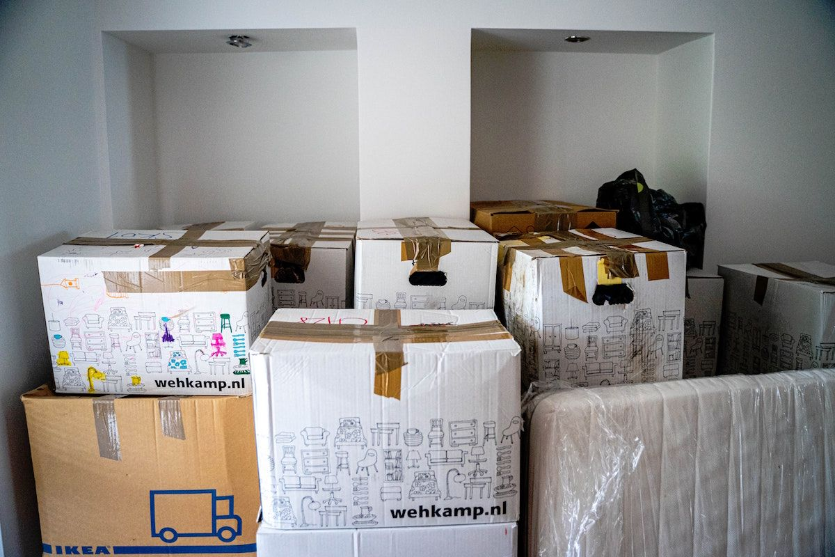 Moving boxes stacked and packed and wrapped furnitured.