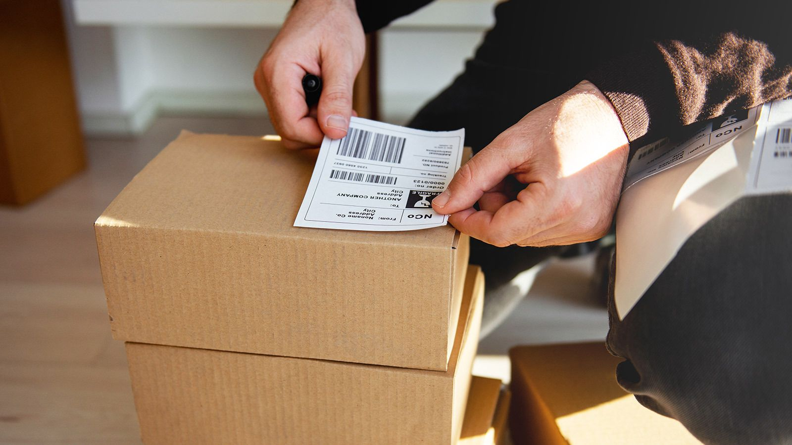 Affixing a prepaid shipping label to a package