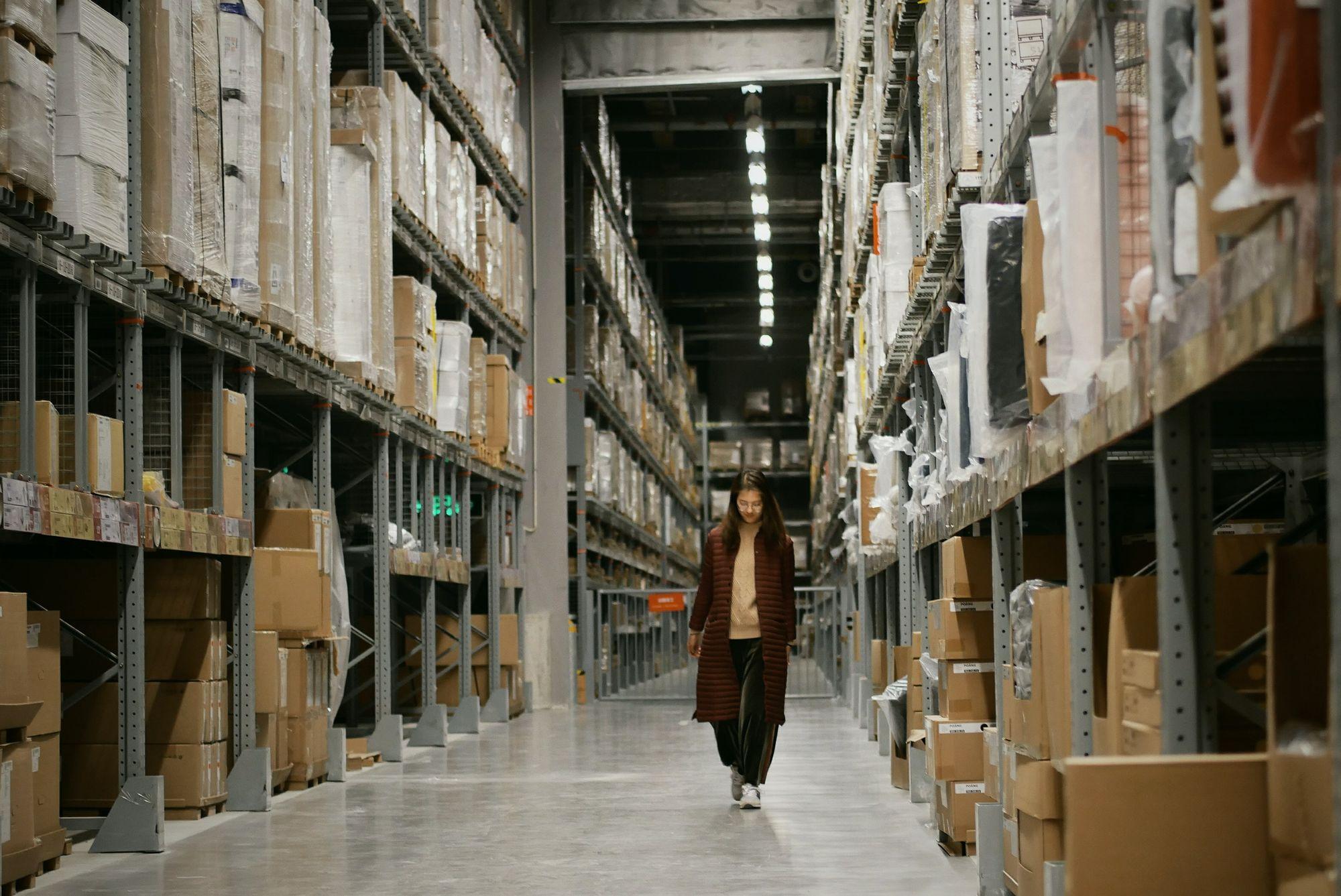 Woman Walking in a New Warehouse